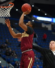 Mar 20, 2019; Hartford, CT, USA; Florida State Seminoles guard M.J. Walker (23) dunks during practice before the first round of the 2019 NCAA Tournament at XL Center. Mandatory Credit: Robert Deutsch-USA TODAY Sports