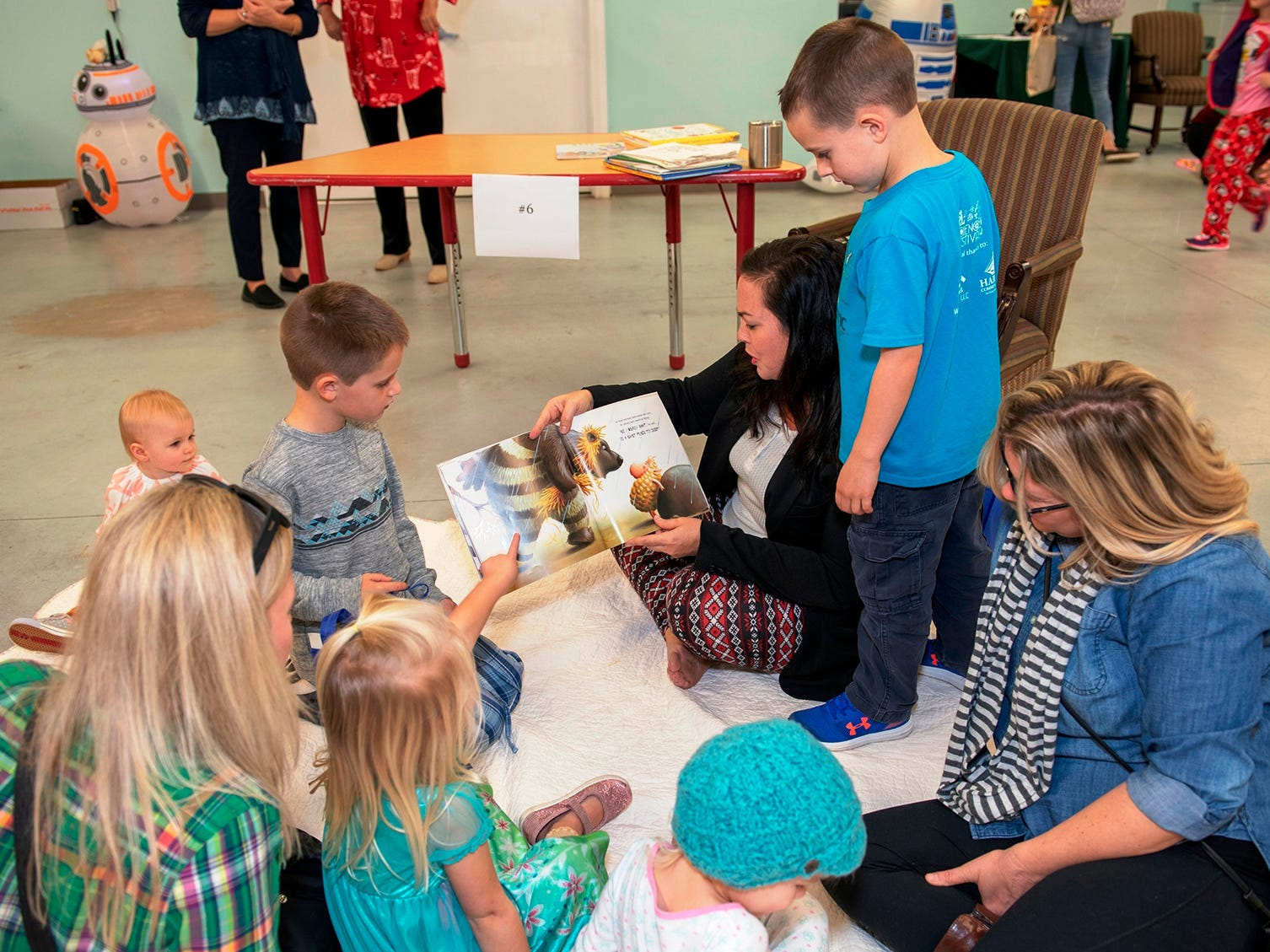 Guest reader Andrea Berry, CEO of Indian River County Healthy Start Coalition, reads to children at the Pajama Jam to benefit The Language & Literacy Connection.