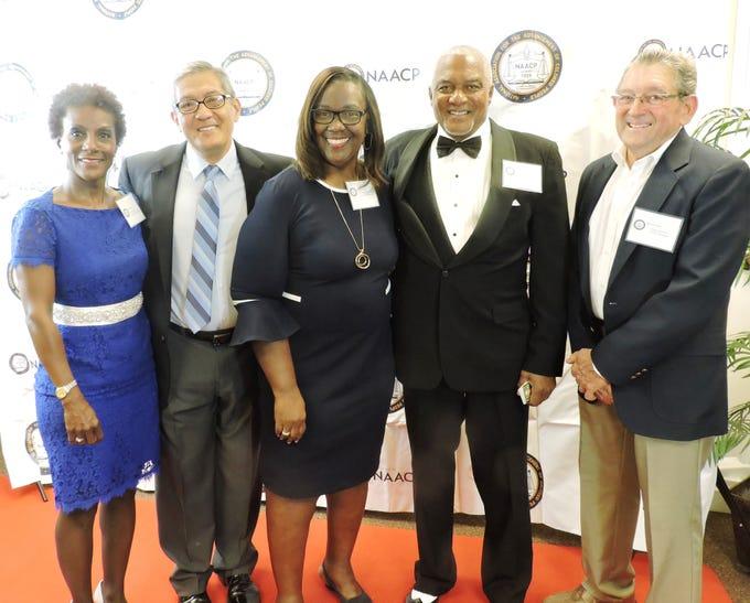 Gloretta Hall, left, Jess Nasciaro, Martin County Chapter of NAACP President Jimmy Smith, Thelma Washington and Dick Landrum, Presidential Award recipient.