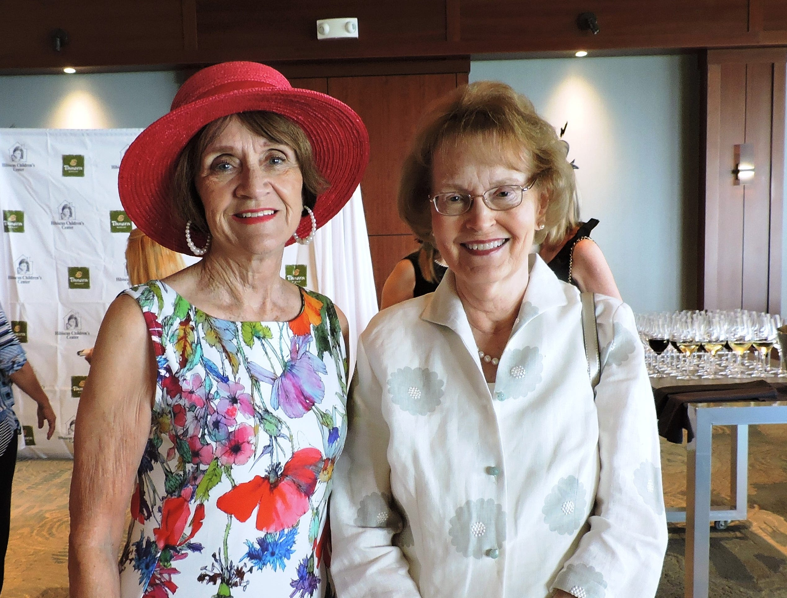 """Molly Hoffman, left, and Judy Mergler at the """"Hats off for Hibiscus"""" luncheon at Sailfish Point Country Club"""