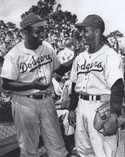 Jackie Robinson and Ray Campanella at Historic Dodgertown during spring training.