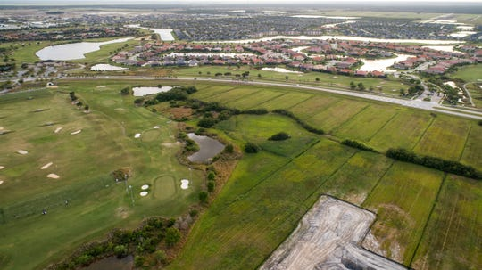 The Viera Co. hopes to add an urban-style college campus near The Avenue Viera, between Lake Andrew Drive and Stadium Parkway, as seen March 11, 2019, in an aerial drone photograph looking southwest over part of Duran Golf Club towards Stadium Parkway.