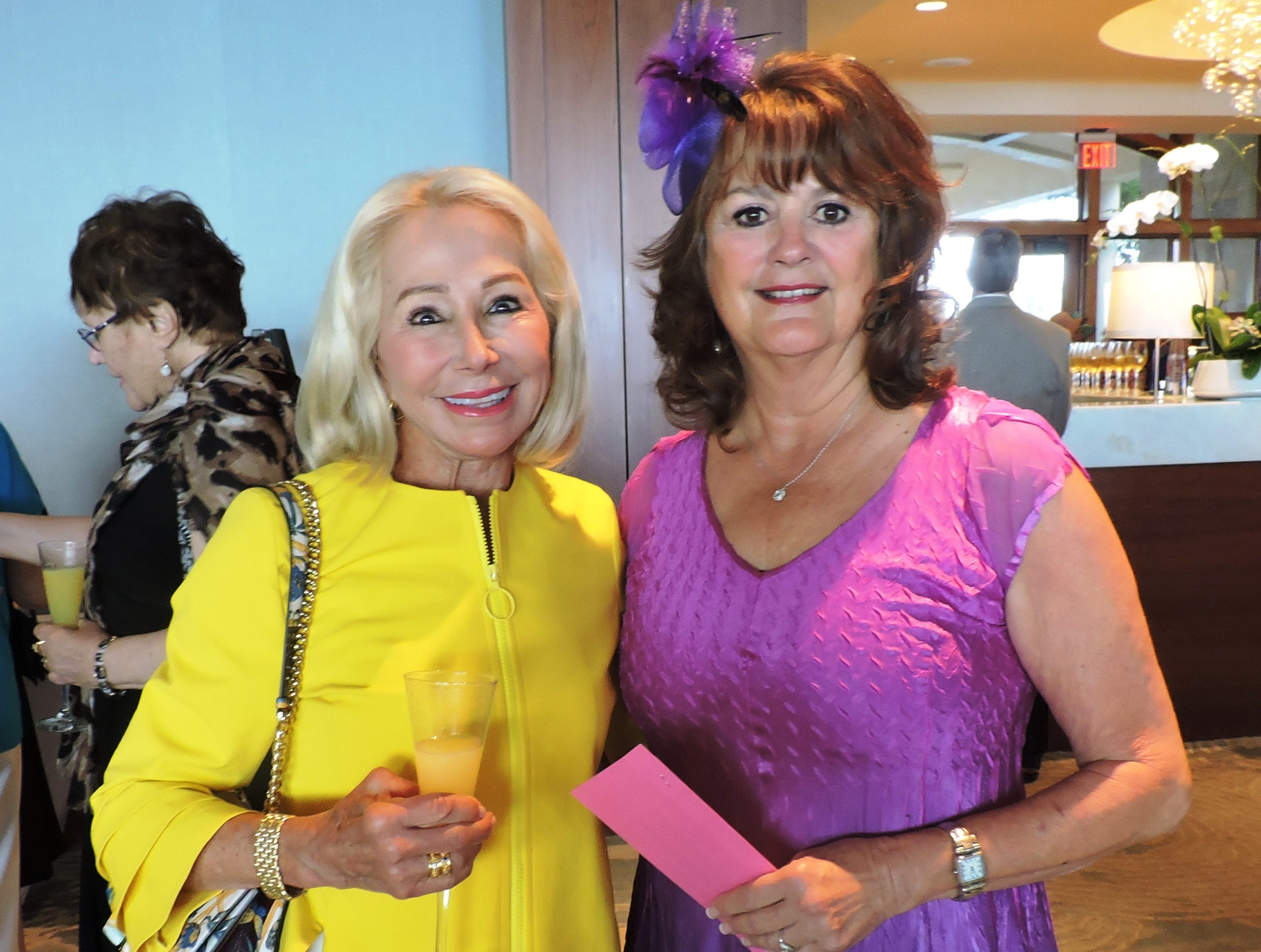 """Annette Ford, left, and Pam Gardner at """"Hats off for Hibiscus"""" luncheon benefit Hibiscus Children's Center."""