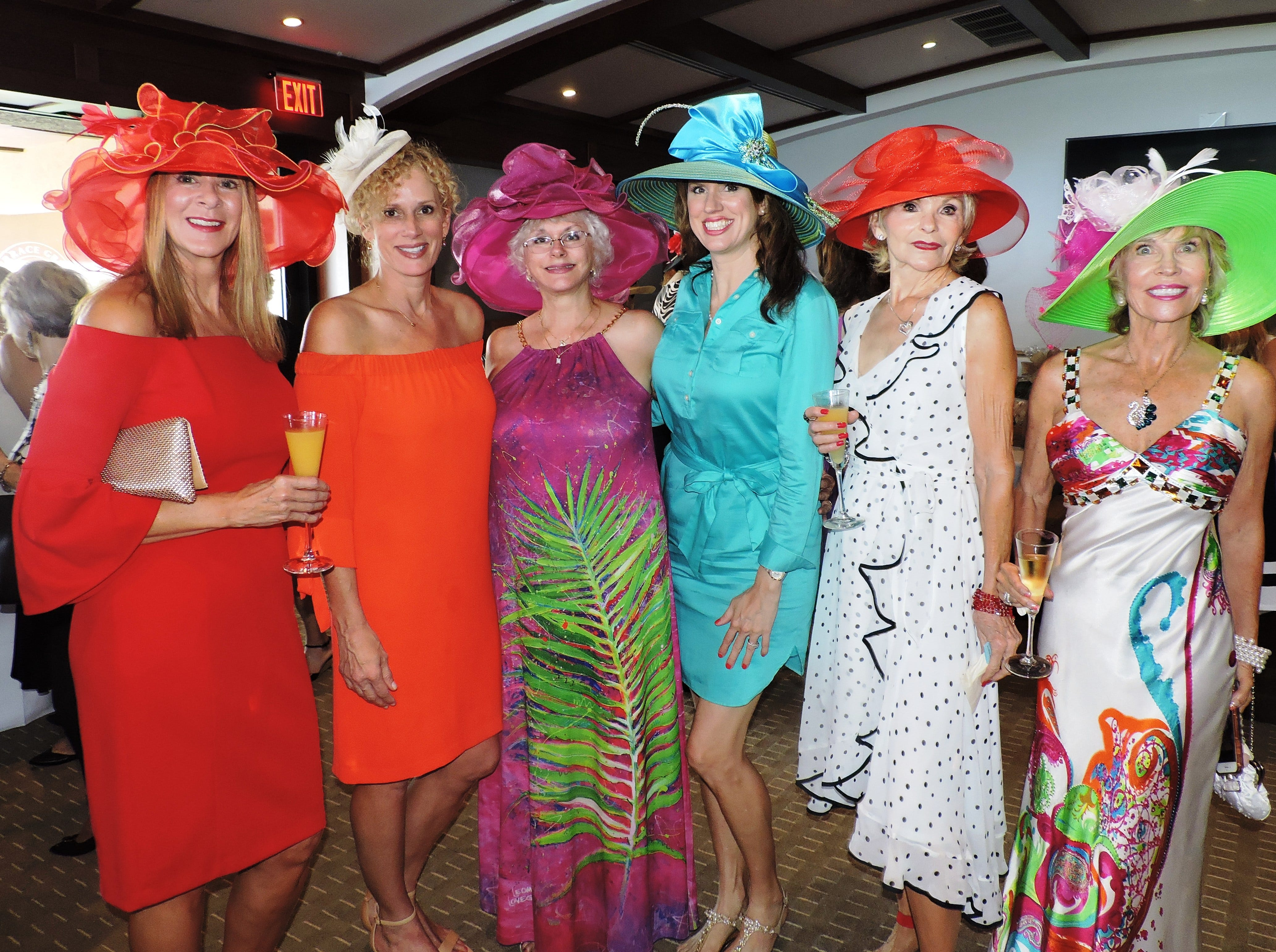 """Jill Wilt, left, Kathryn Anson, Jan Kleman, Lauri Burgess, AnnMarie Coppola and Joanne Caras at the """"Hats off for Hibiscus"""" luncheon atSailfish Point Country Club."""