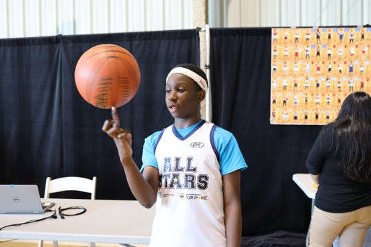 Indian River County Boys & Girls Clubs member Ethan shows off his basketball skills at the Angels Dinner on March 6.