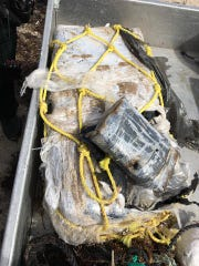Deputies found over 55 pounds of cocaine wrapped in plastic in Fort Pierce Wednesday.