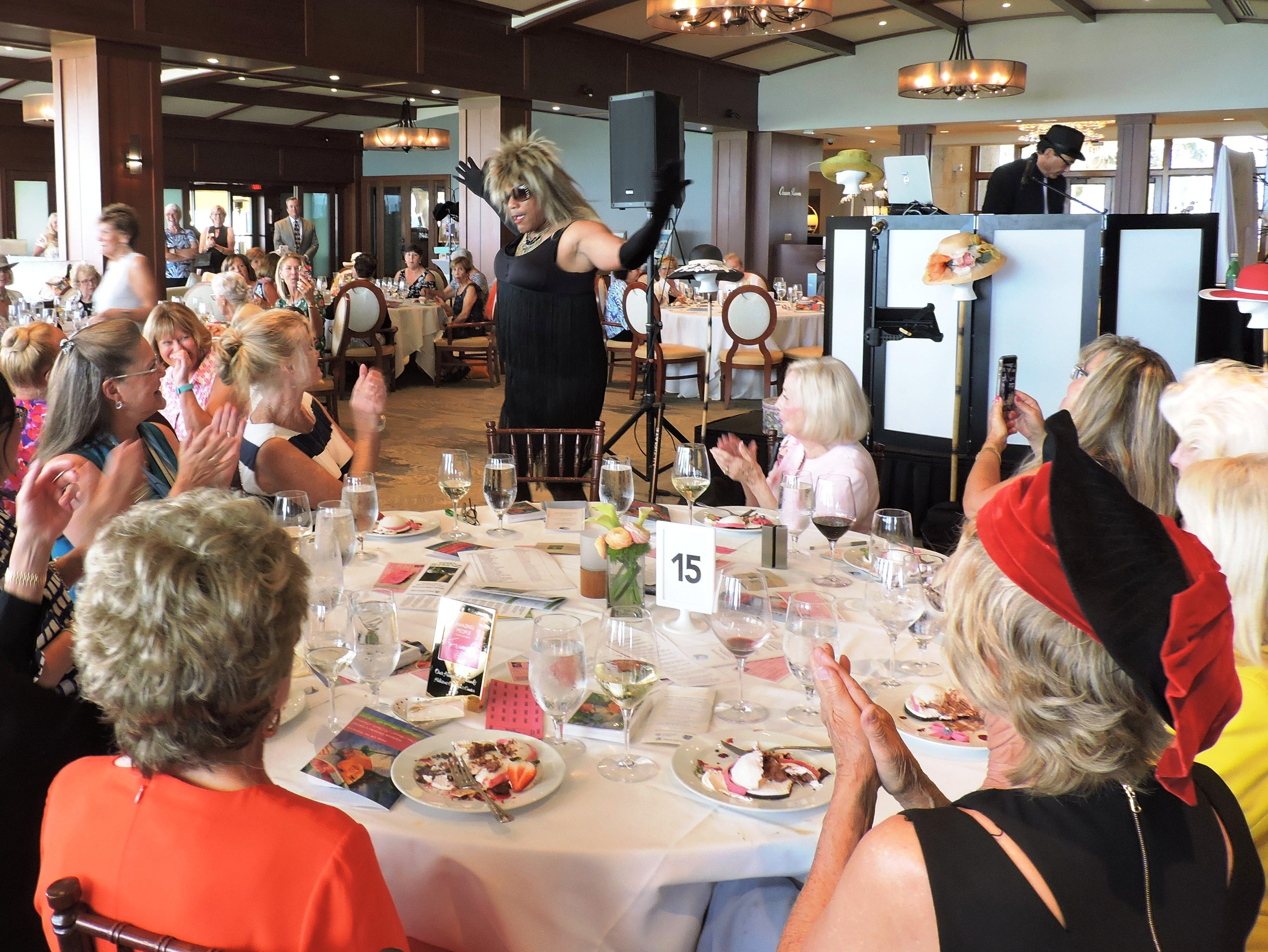 Singer Daryl Magill as Tina Turner at the 28th annual Jo Covelli Luncheon to benefit Hibiscus Children's Center.