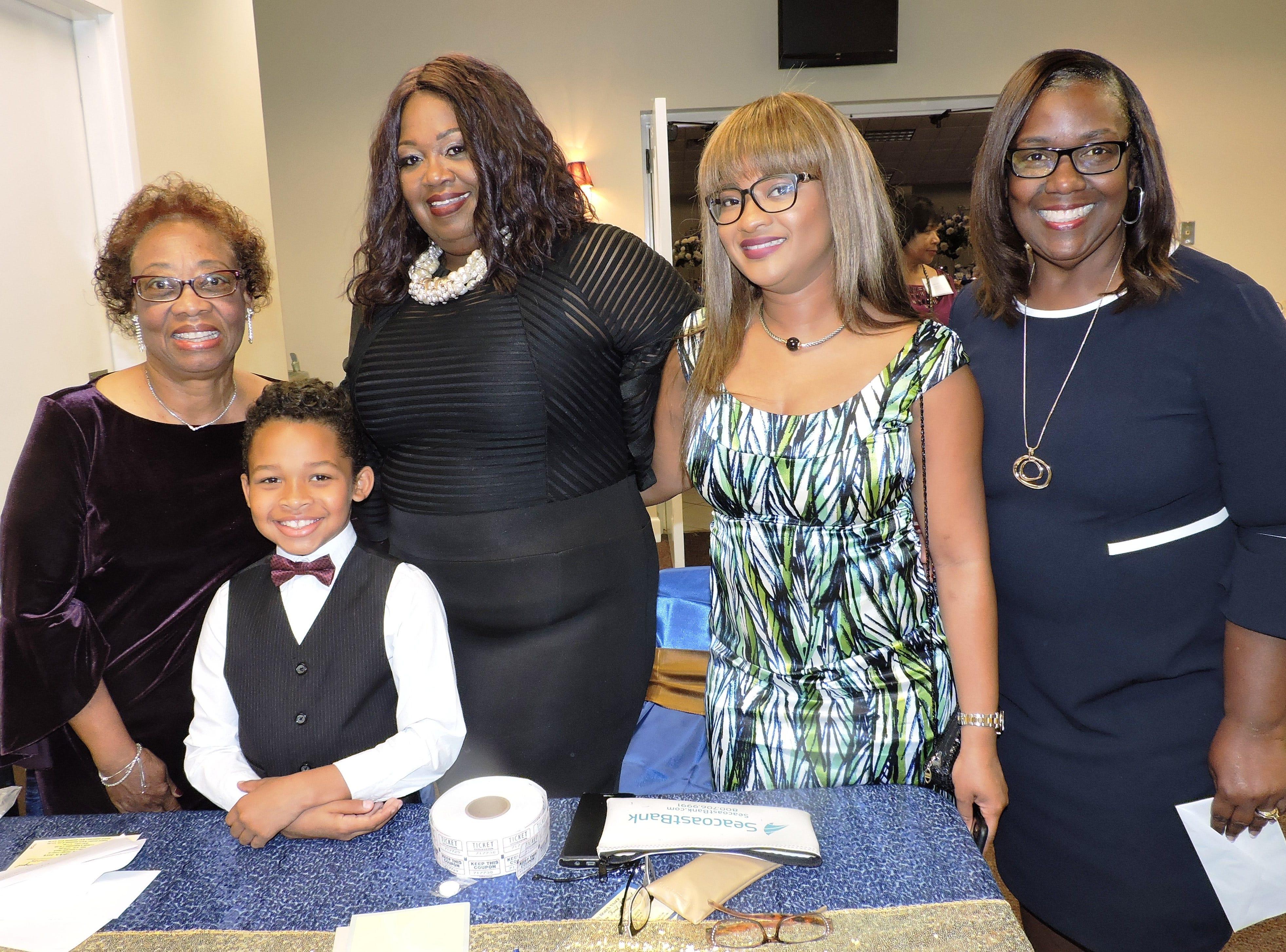 Gladys Clark, left, Lextin Clark, Brenda Matheny, Mia Pintard and Thelma Washington at the 2019 Freedom Fund Banquet.