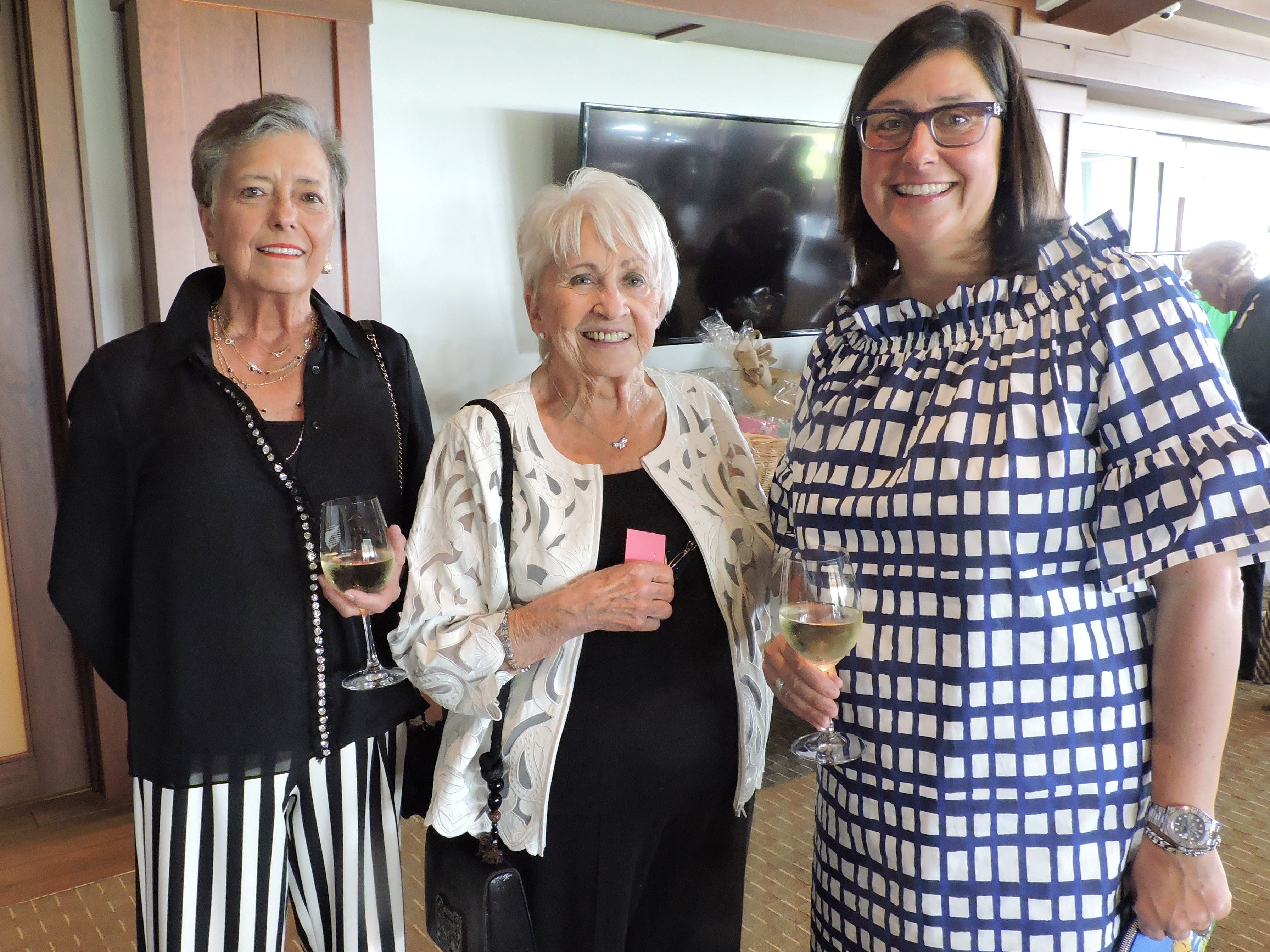 """Jeanne O'Neil, left, Dianne Krahnert and Christine D'Hondt at """"Hats off for Hibiscus"""" luncheon."""