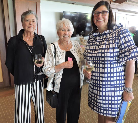 "Jeanne O'Neil, left, Dianne Krahnert and Christine D'Hondt at ""Hats off for Hibiscus"" luncheon."