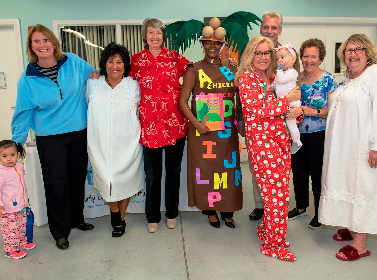 Guest readers, from left, Elly Nguyen; Laura Haase, director of program operations, Children's Service Council of Martin County; Carol Houwaart-Diez, president/CEO, United Way of Martin County; Pat Houston, director of programs, Early Learning Coalition of Indian River, Martin and Okeechobee Counties; Wendy Reynoso, executive director, Dunbar Early Learning Center;  David Heaton, executive director, Children's Services Council of Martin County; Cher Fisher, Helping People Succeed board secretary;  Alden Speedy, Bliss Browne, Helping People Succeed board president and Suzy Hutcheson, president/CEO of Helping People Succeed at Pajama Jam to benefit The Language & Literacy Connection.