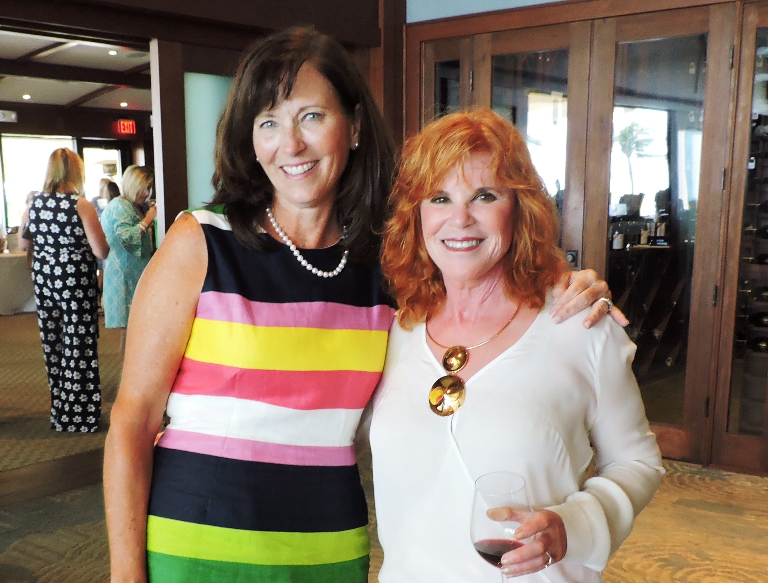"""Lori Corcoran, left, and Robin Berger at the """"Hats off for Hibiscus"""" luncheon atSailfish Point Country Club."""
