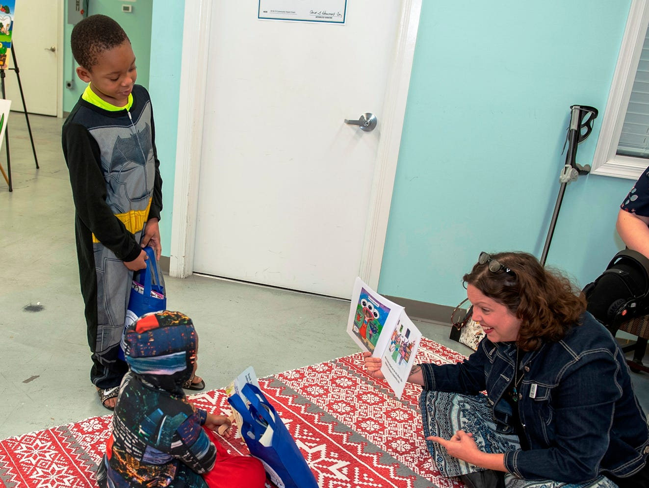 Guest reader Tammy Kaiser, right, director of Temple Beit HaYam's early Childhood Learning Center, at Pajama Jam to benefit The Language & Literacy Connection.
