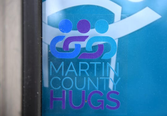 The Martin County HUGS window cling, distributed to patients at the Community Care Specialized Adult Care Center by Martin County Fire Rescue on Wednesday, March 20, 2019, in Stuart, helps first responders identify homes where a person living with some sort of dementia resides.