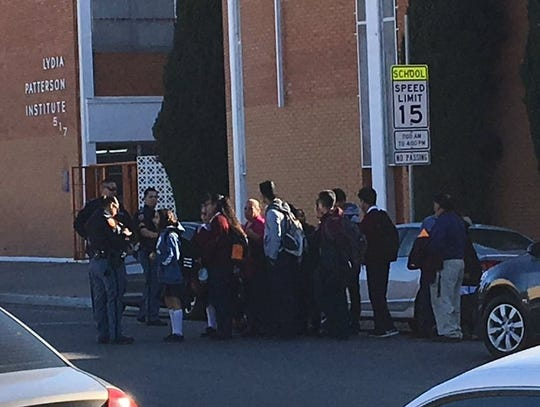 Students are released Tuesday after a lockdown at Lydia Patterson Institute after a shooting in El Paso near the Mexican Consulate.