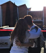 Hugs greet students Tuesday after a school lockdown at the Lydia Patterson Institute in El Paso after a suspected shooter ran onto the Segundo Barrio campus after a shooting near the Mexican Consulate.