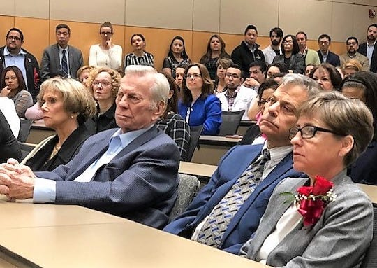Jack Cardwell, left, and his son, Jim Cardwell and his wife, Julie, attend a ceremony Wednesday at the Texas Tech University Health Sciences Center El Paso campus honoring the Cardwell family's $750,000 donation to the school.