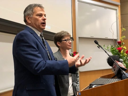 El Paso businessman Jim Cardwell and his wife, Julie, talk Tuesday at a ceremony honoring them for donating $750,000 to Texas Tech University Health Sciences Center El Paso to help ease the area's neurologist shortage.