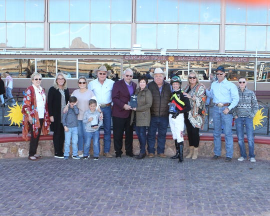 The winning connections of Hustle Up celebrate the horse's win in the Feb. 24 Mine That Bird Derby at Sunland Park Racetrack & Casino.