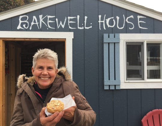 Deb Dawson, owner of the Ventura-based catering and food-truck business Desserts to Die For, poses in front of Bakewell House, a pop-up project. She is holding a Bakewell tart, a confection named for a small town in Derbyshire, England.