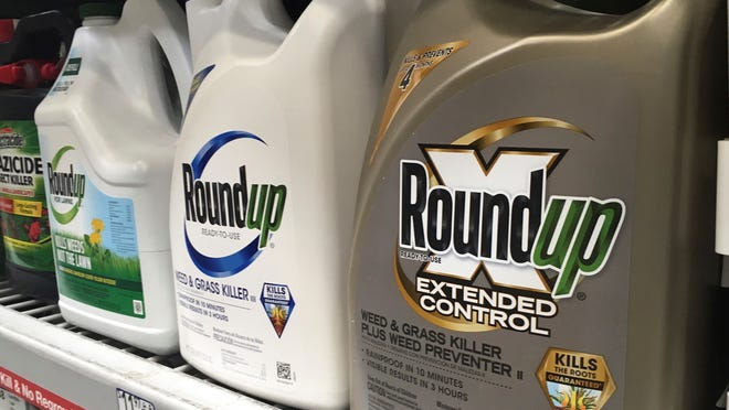 Containers of Roundup are shown in this file photo.