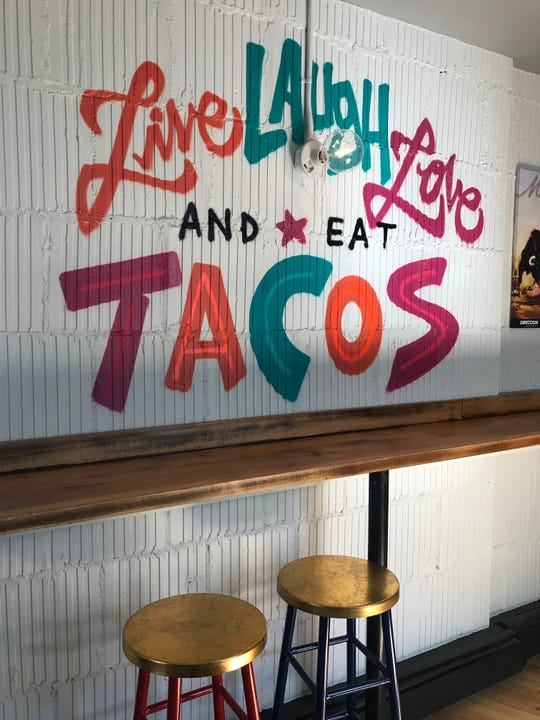 The mural with the motto of The Taco Project. The new restaurant opens March 21 in Bronxville.