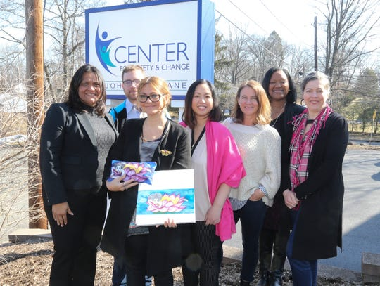 Nyack artist Marisol Diaz, center, holding her artwork and the gift bag she designed,  flanked from left to right, Elizabeth Santiago, executive director of the Center for Safety and Change, Joshua Wolfe, SkyPunch Creative; Am S. Bouton, Mata USA; Shannon Burch, Soap & Paper Factory; Tracie McLee, Center for Safety and Change; Stephanie Mikosvary, Lucky Chic; at Center for Safety and Change in New City on Wednesday, March 20, 2019.