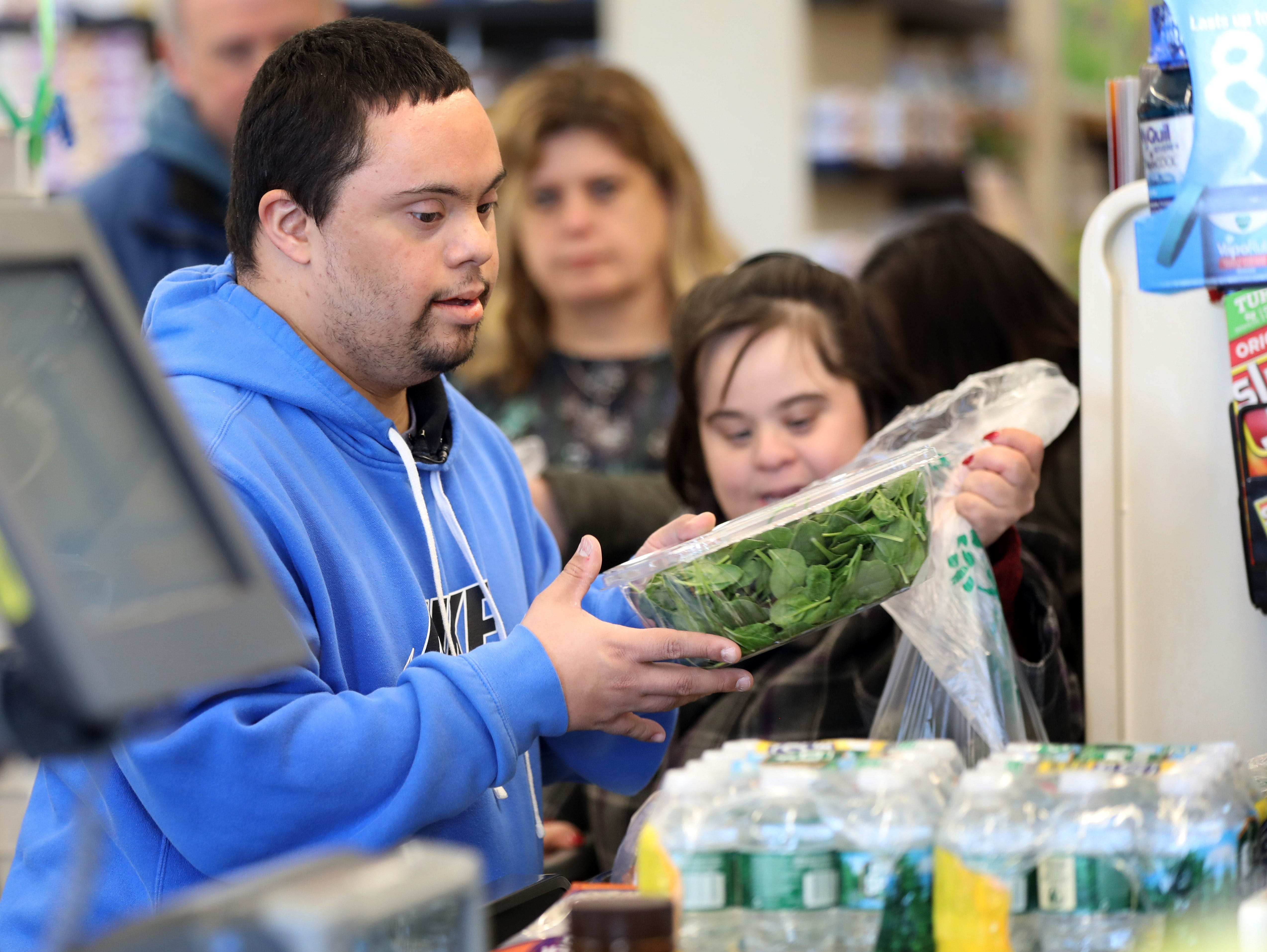 Anthony Mundy, 29 takes the groceries out of the shopping cart after shopping for lunch with members of his day program at Jawonio at ShopRite in Airmont March 12, 2019.