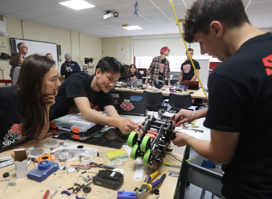 From left, Tappan Zee's robotics team members Lucy Barsanti, 16, Kevin Huang, 18, and Giovanni Lopresti, 15, works on the arm of the team's robot at Tappan Zee High School in Orangeburg March 18, 2019. SO BOTZ Team #6911 are apart of a national robotics competition called For Inspiration and Recognition of Science and Technology, FIRST for short.