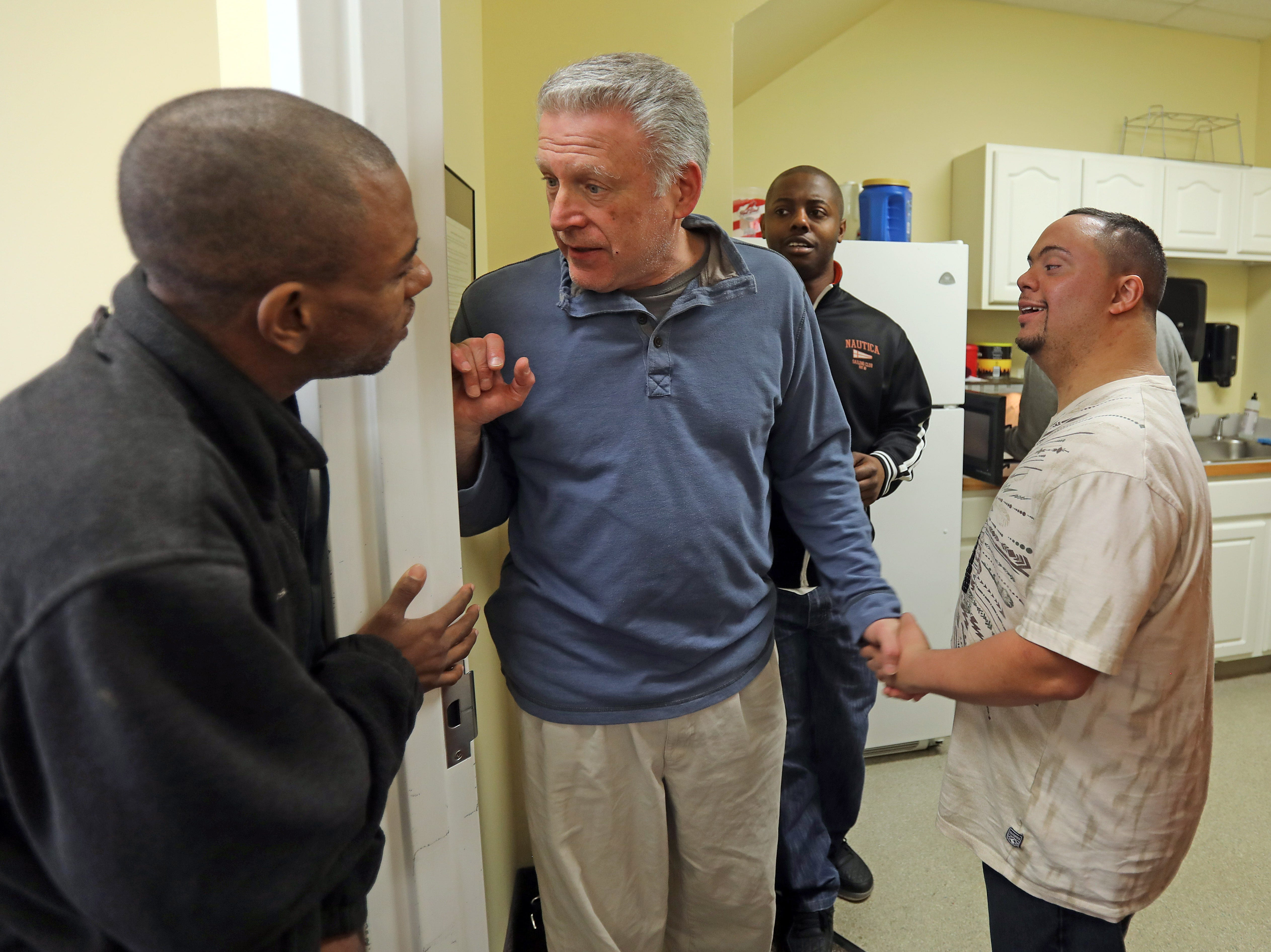 Anthony Mundy, 29, right, hangs out with Sebastien Castel, left, Dean, center, and Tyshawn Stewartson, right, during a day program at Jawonio called Without Walls or WOW in Spring Valley March 14, 2019.
