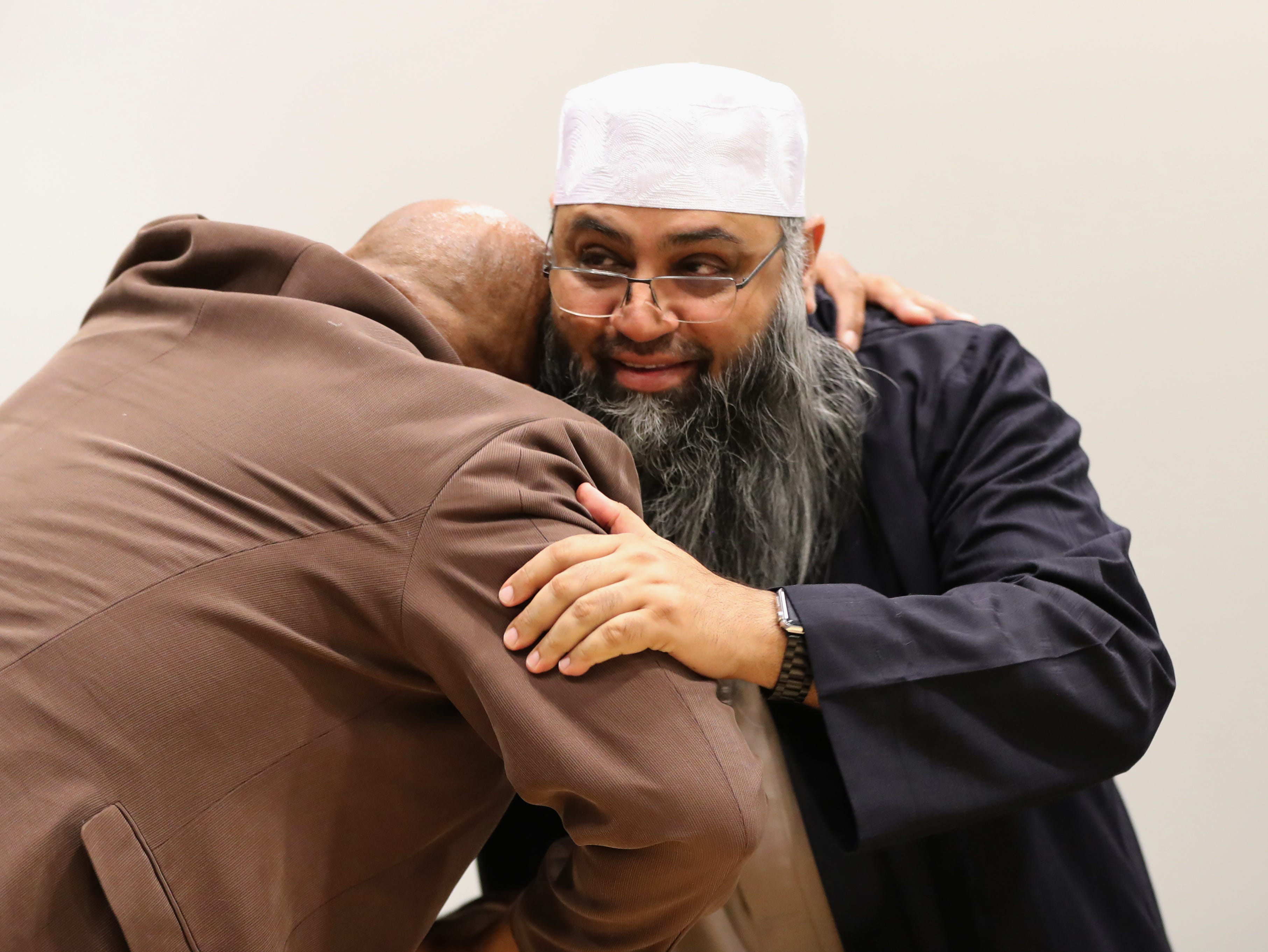 Minister Wesley King hugs Imam Syed Ali after the Interfaith Symposium held at Rockland Community College March 20, 2019.