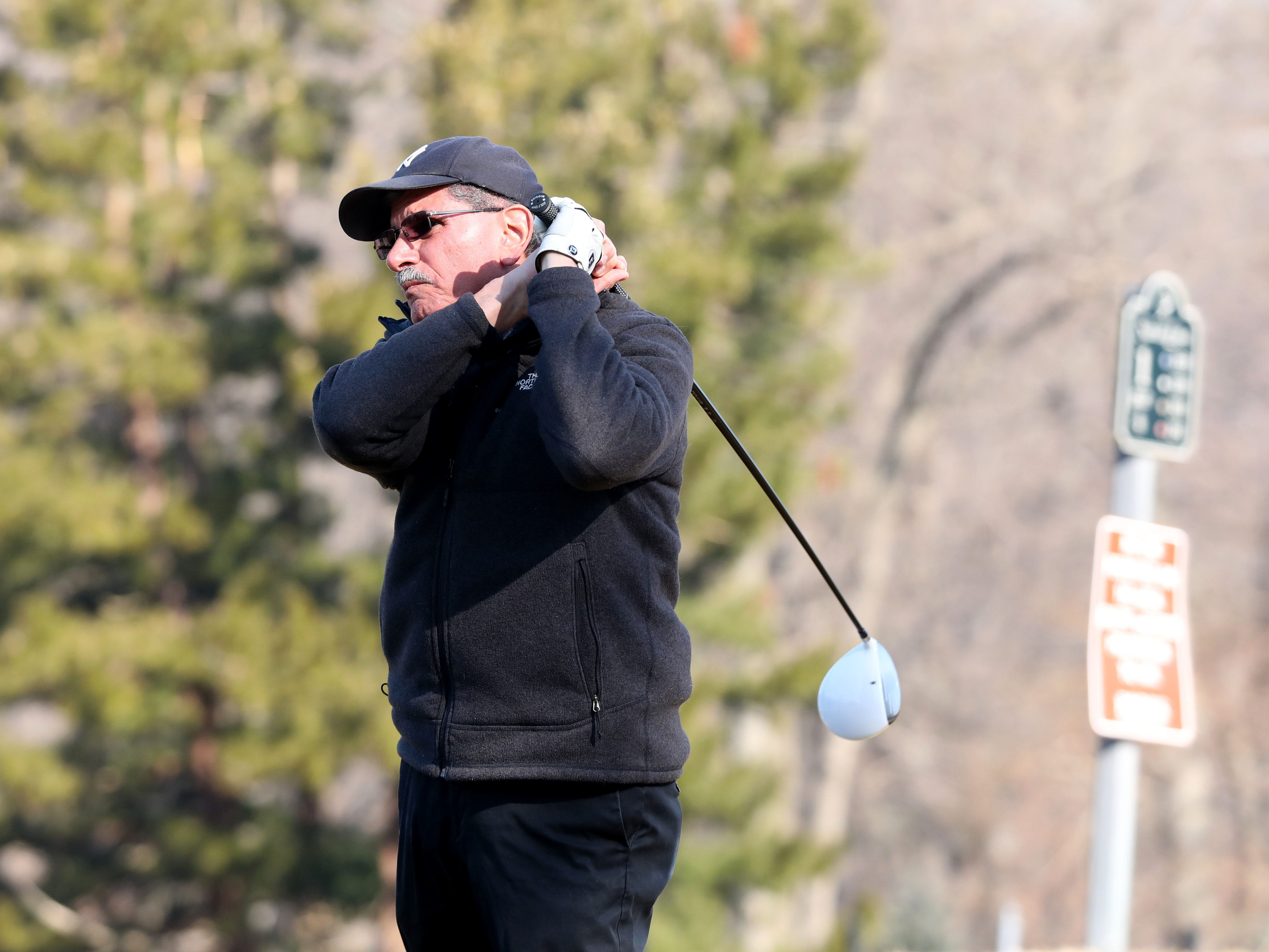 "Jerry Sgueglia from Yorktown hits from the first tee, after waiting out a three hour ""frost delay"" during the opening day of golfing at Sprain Lake Golf Course in Yonkers, March 20, 2019."