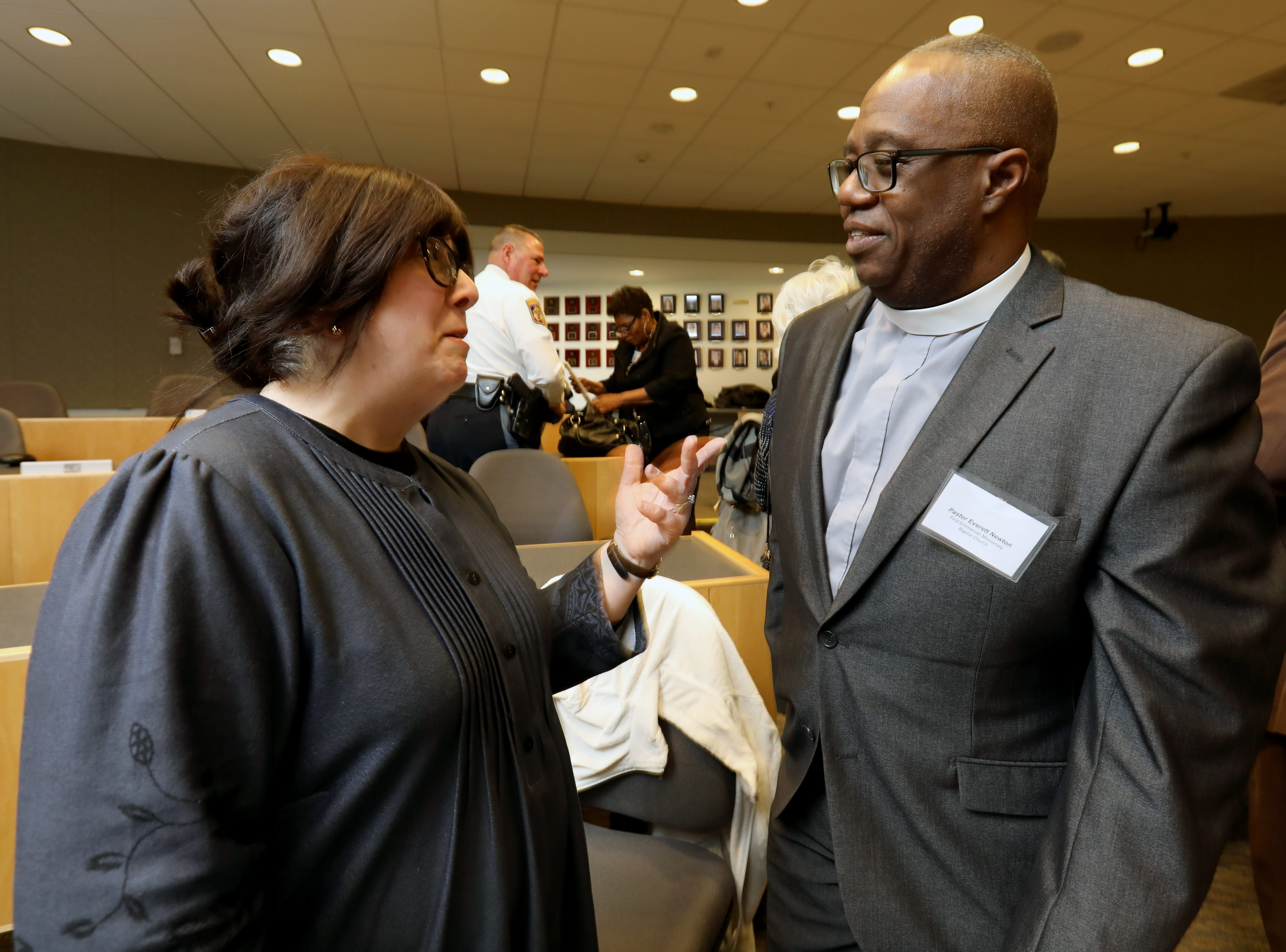 Shani Bechhofer of Monsey talks with Pastor Everett Newton after the Interfaith Symposium held at Rockland Community College March 20, 2019.