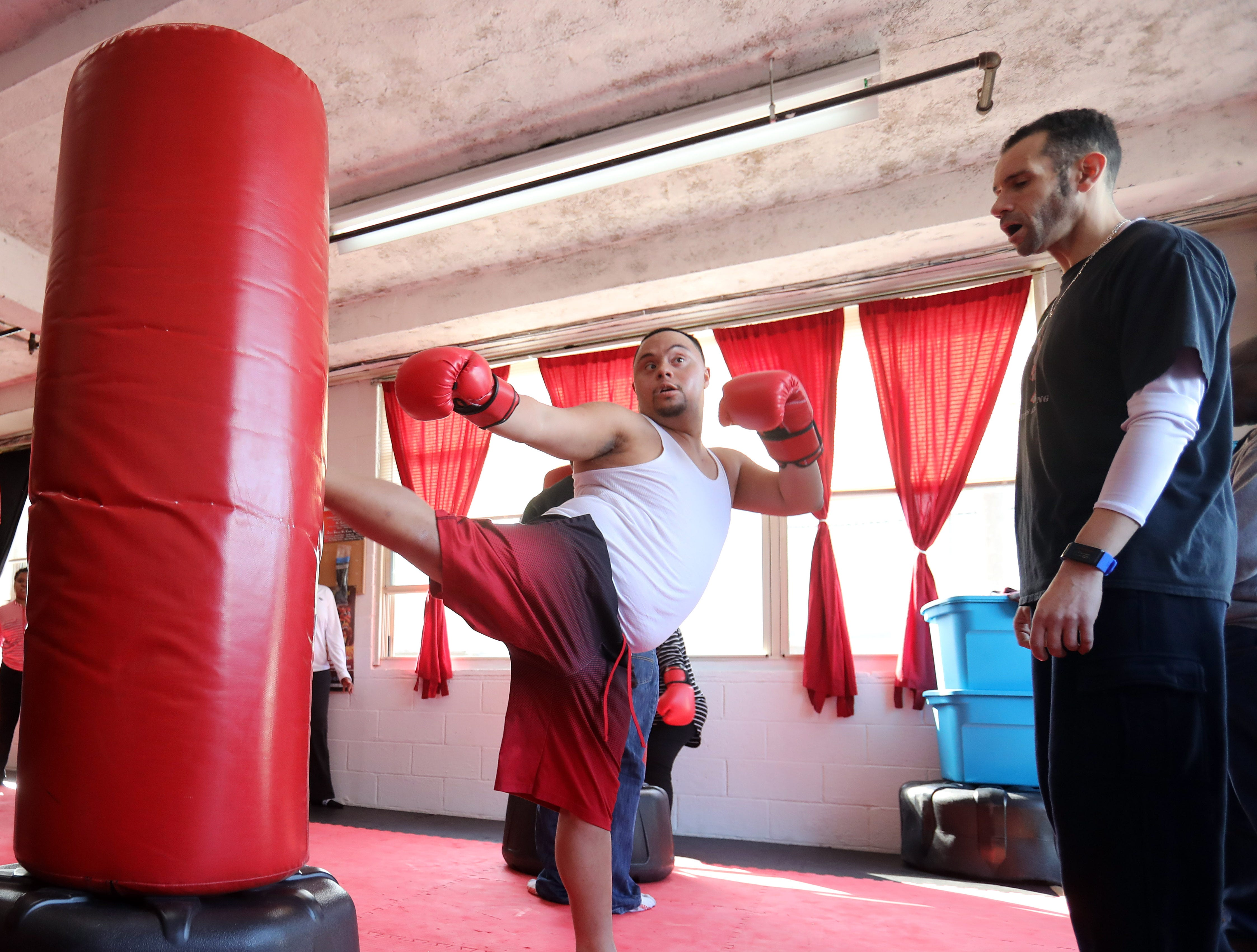 Trainer Amir gives Anthony Mundy, 29 some pointers on his kick during a kick boxing class at Anubis Fitness in Nyack March 14, 2019.