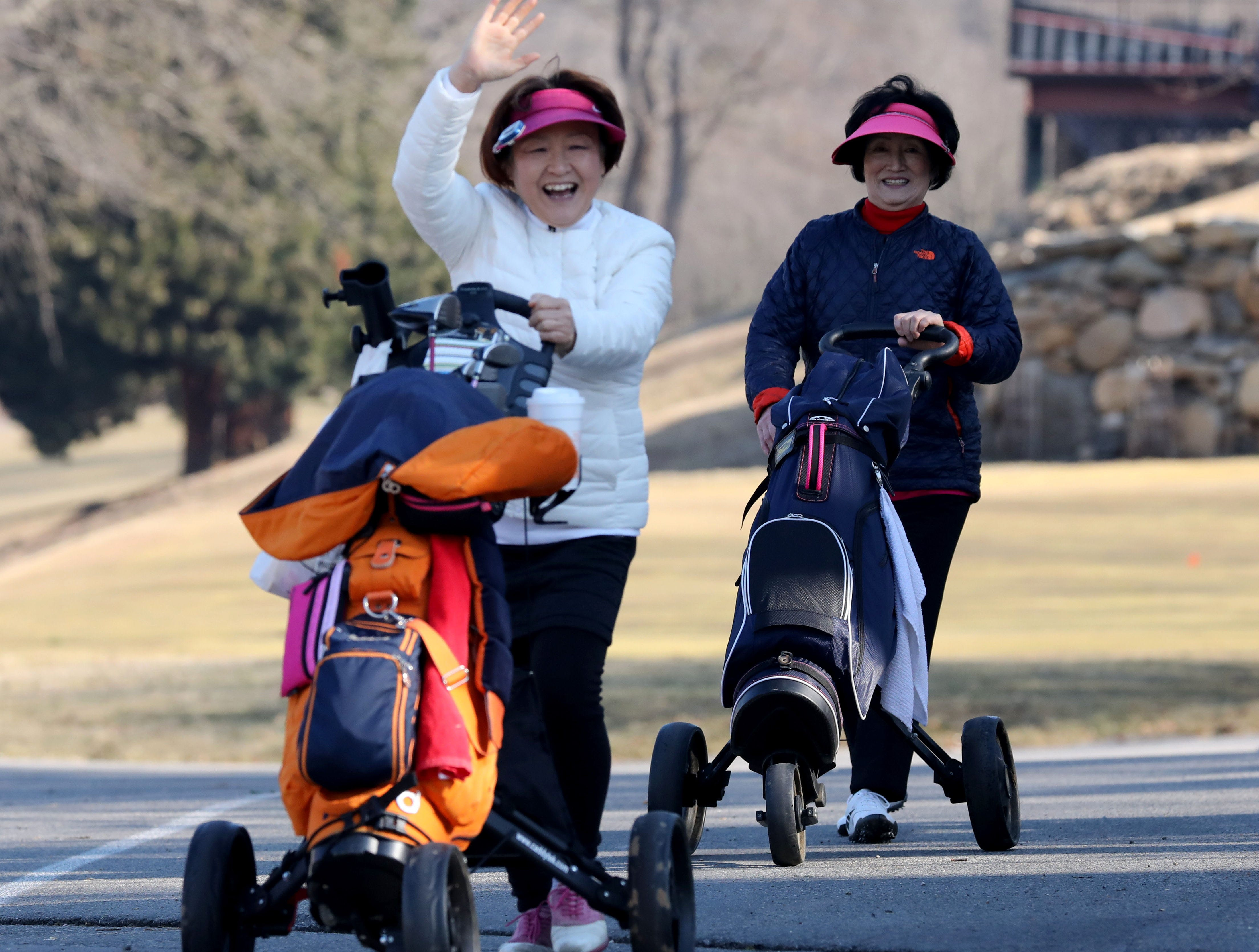 "Jeong Soon Choi and Young Ye Chung both from Yonkers head for the first tee after waiting out a three hour ""frost delay"" during the opening day of golfing at Sprain Lake Golf Course in Yonkers, March 20, 2019."