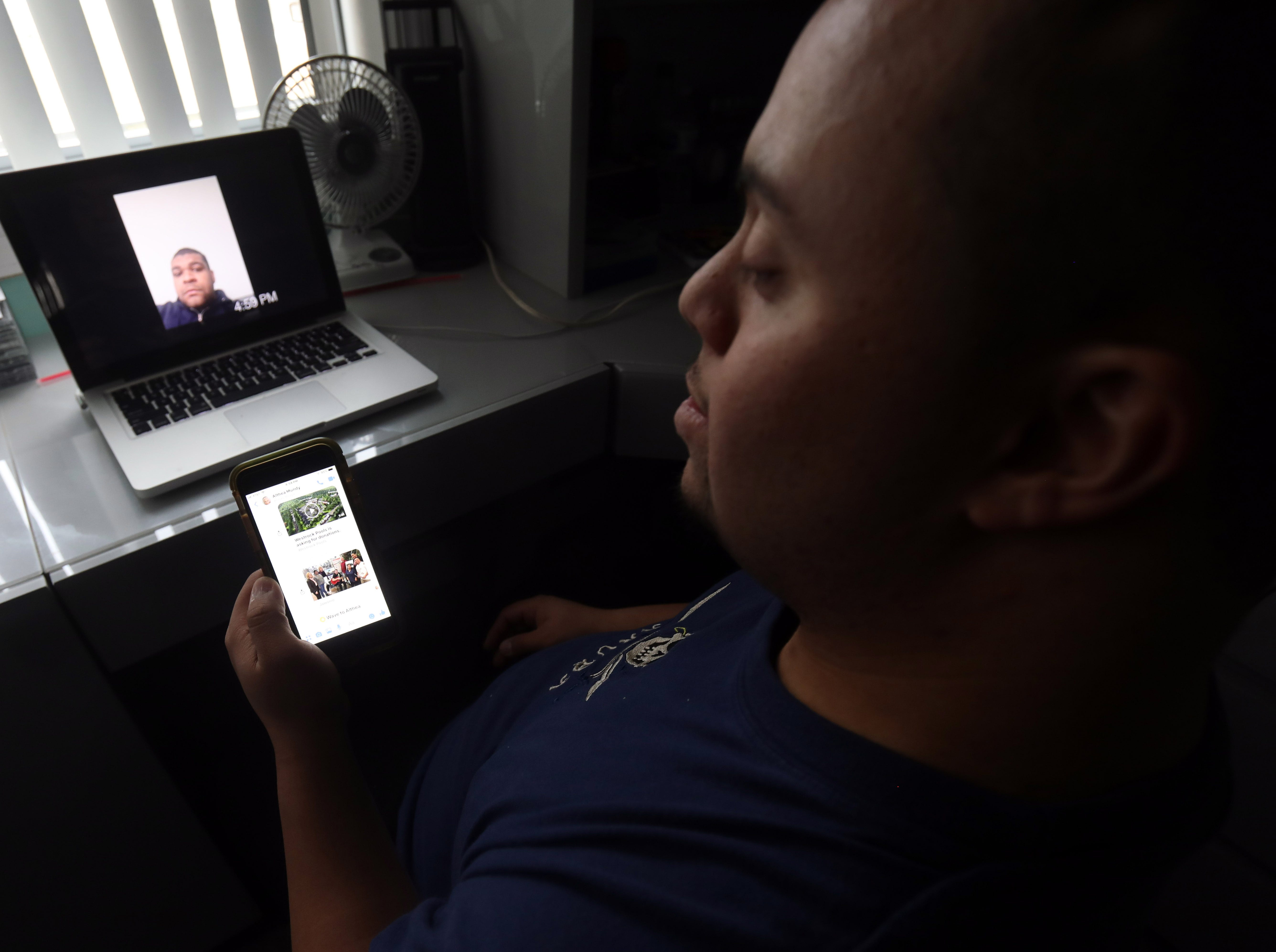 Anthony Mundy, 29 sends his older brother a picture from his phone in his room in Spring Valley March 15, 2019.