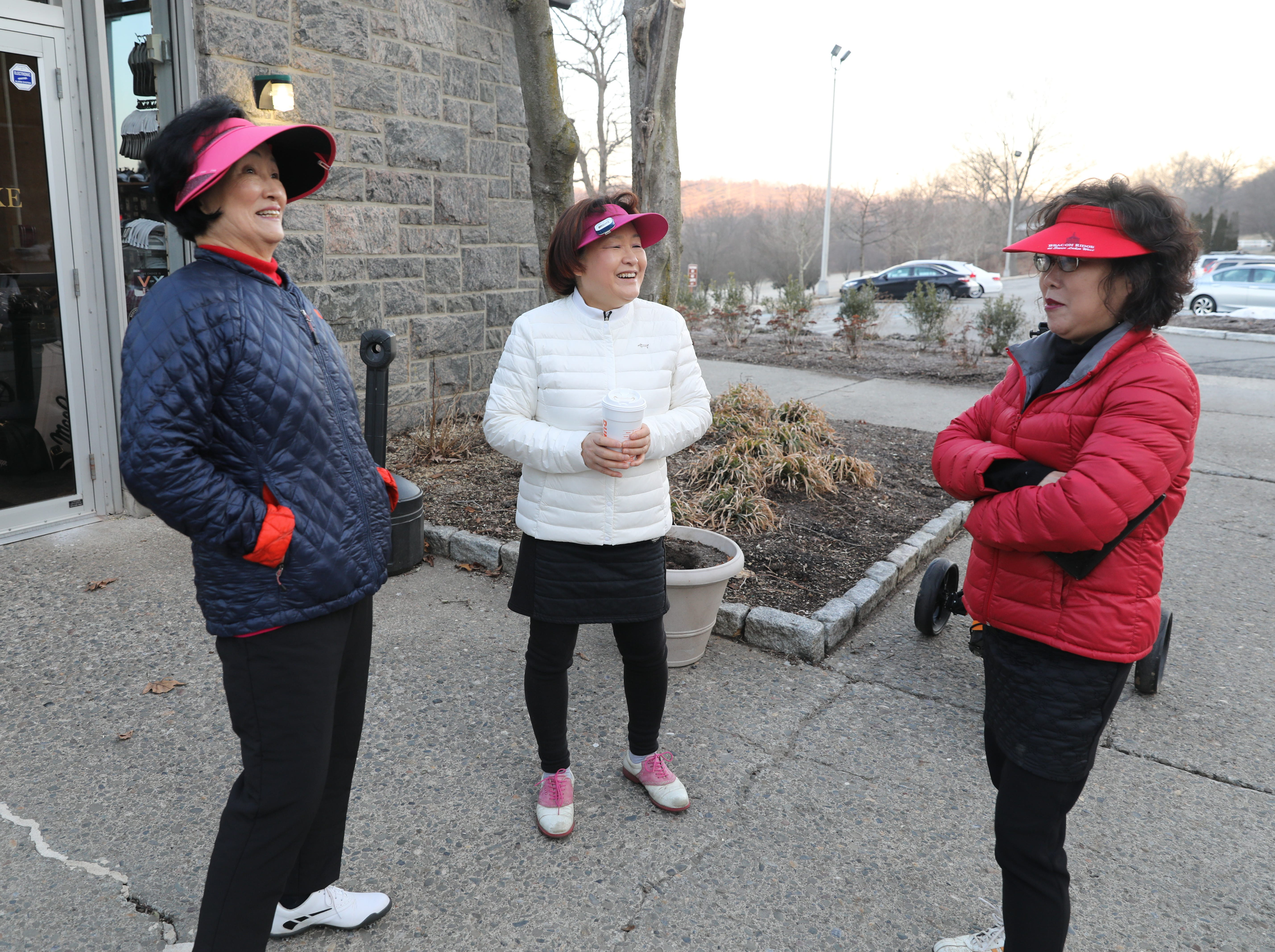 "From left: Young Ye Chung and Jeong Soon Choi both from Yonkers and Kiae Yun from Harrison, wait out a three hour ""frost delay"" during the opening day of golfing at Sprain Lake Golf Course in Yonkers, March 20, 2019."