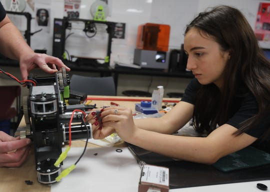Tappan Zee's robotics team members Lucy Barsanti, 16, works on the arm of the team's robot at Tappan Zee High School in Orangeburg March 18, 2019. SO BOTZ Team #6911 are apart of a national robotics competition called For Inspiration and Recognition of Science and Technology, FIRST for short.