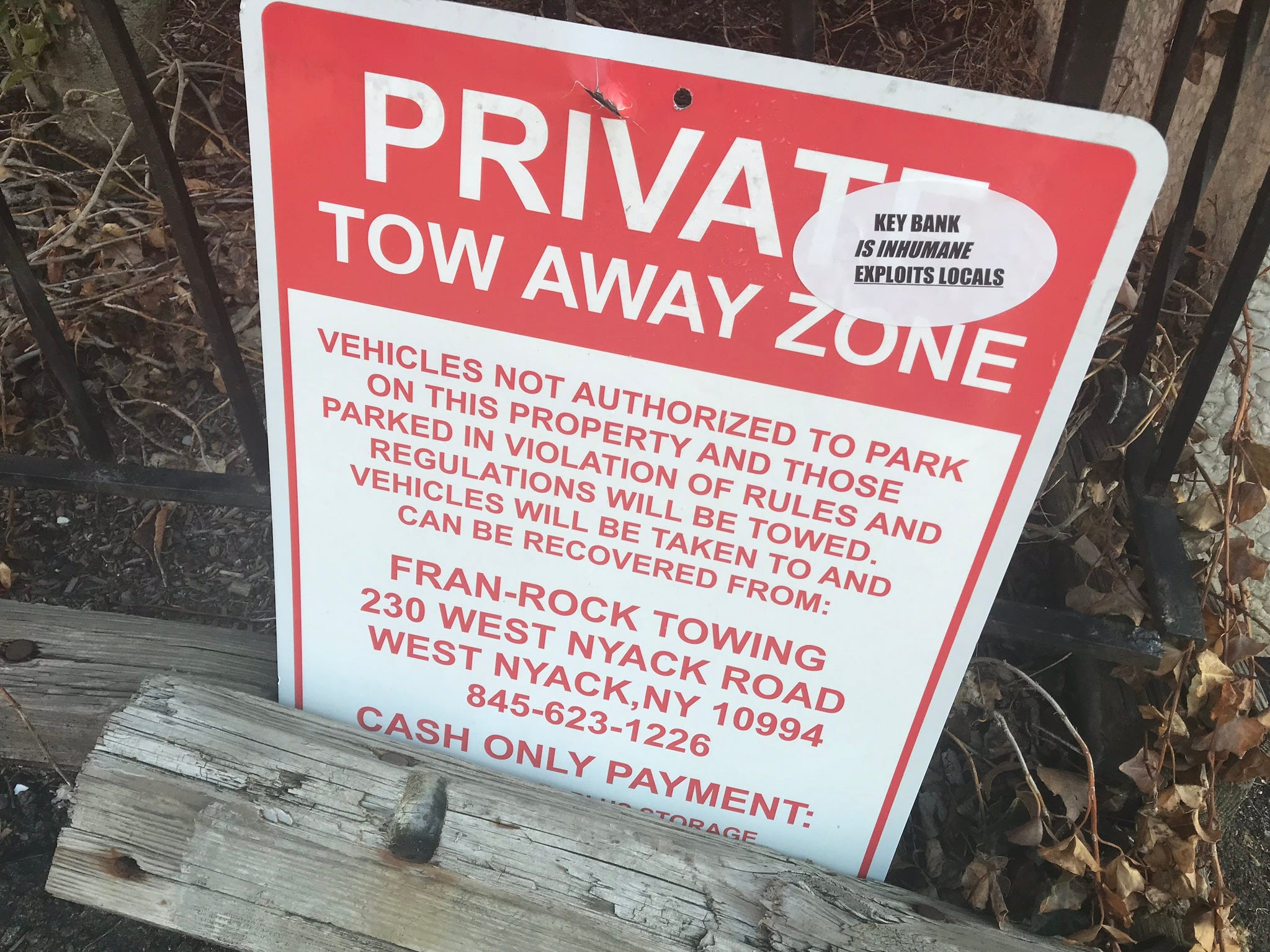 Protesters covered the sidewalk and parking signs at Nyack's Key Bank branch with stickers and graffiti on March 19, 2019, over the bank's policy of towing unauthorized cars from its parking lot. Mayor Don Hammond last week pulled his personal accounts from the bank and suggested he'd pursue an effort to pull the village's $2.6 million in deposits from the branch over what he calls unneighborly actions.