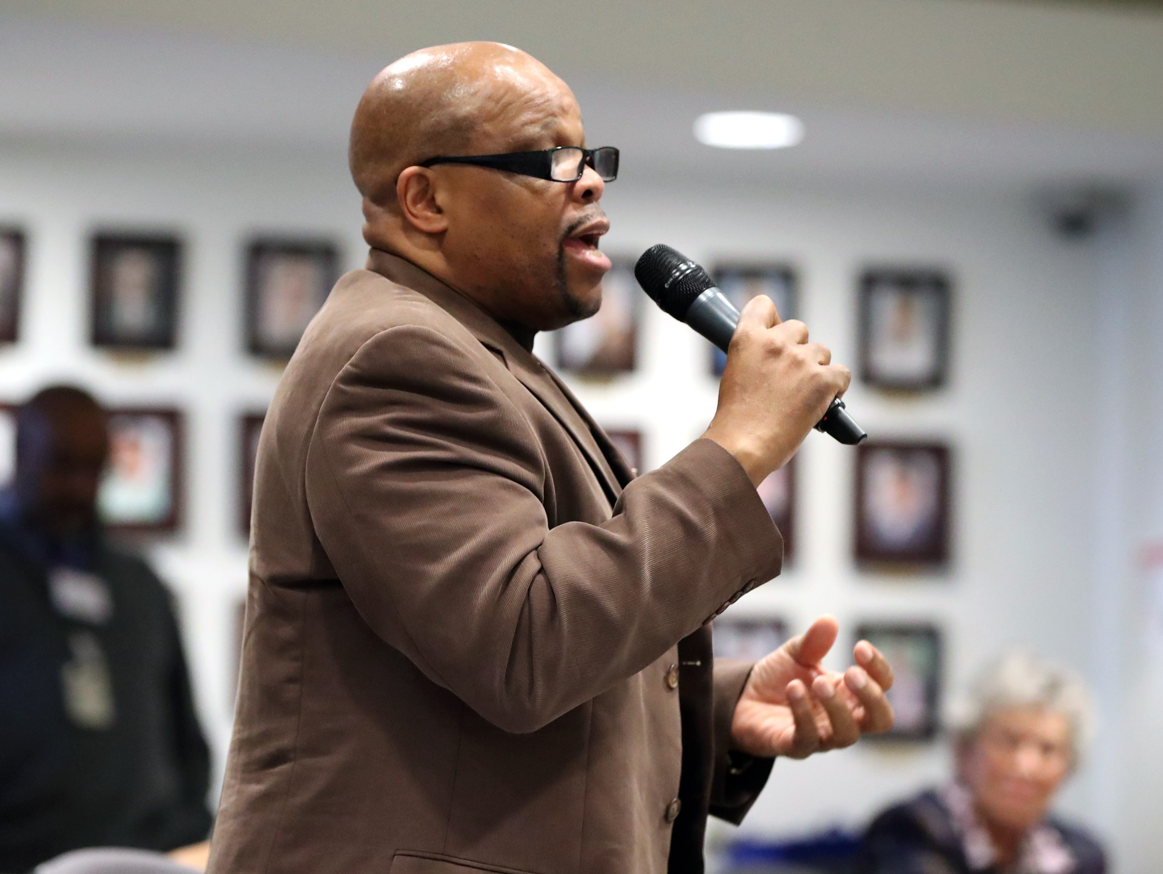 Minister Wesley King asks a question during the Interfaith Symposium held at Rockland Community College March 20, 2019.