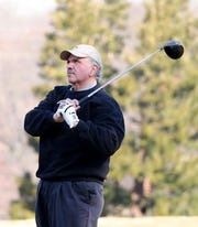 """Carmine Sgueglia from New City hits from the first tee, after waiting out a three hour """"frost delay"""" during the opening day of golfing at Sprain Lake Golf Course in Yonkers, March 20, 2019."""