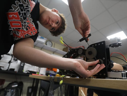 Tappan Zee's robotics team members Giovanni Lopresti,15, works on the arm of the team's robot at Tappan Zee High School in Orangeburg March 18, 2019. SO BOTZ Team #6911 are apart of a national robotics competition called For Inspiration and Recognition of Science and Technology, FIRST for short.