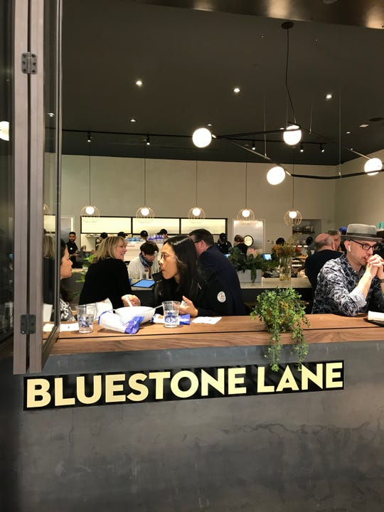 Bluestone Lane has windows that look outside to the mall at The Shops at Hudson Yards. Photographed March 18, 2019.
