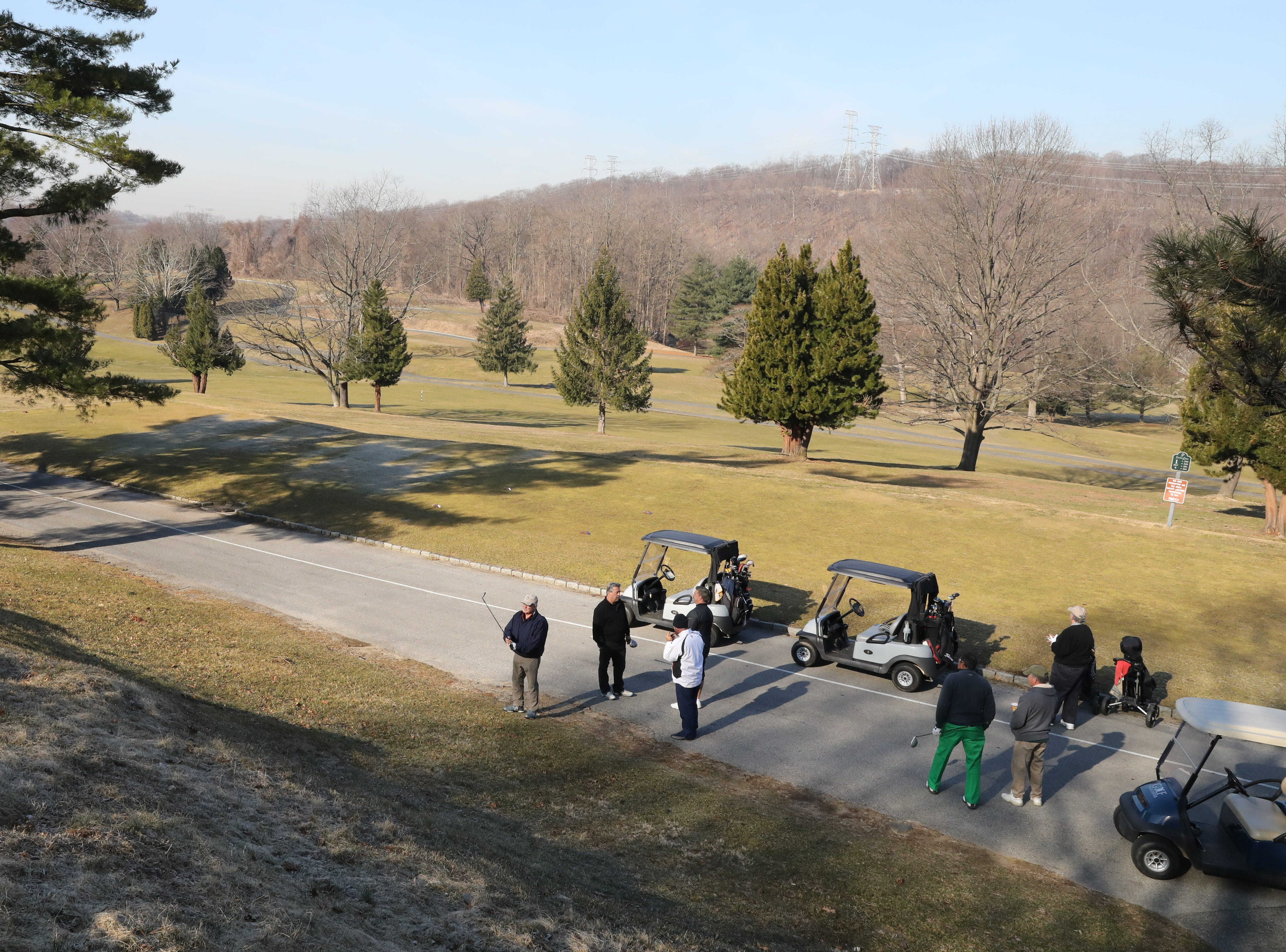 "Golfers take practice swings near the first after a three hour ""frost delay"" during the opening day of golfing at Sprain Lake Golf Course in Yonkers, March 20, 2019."