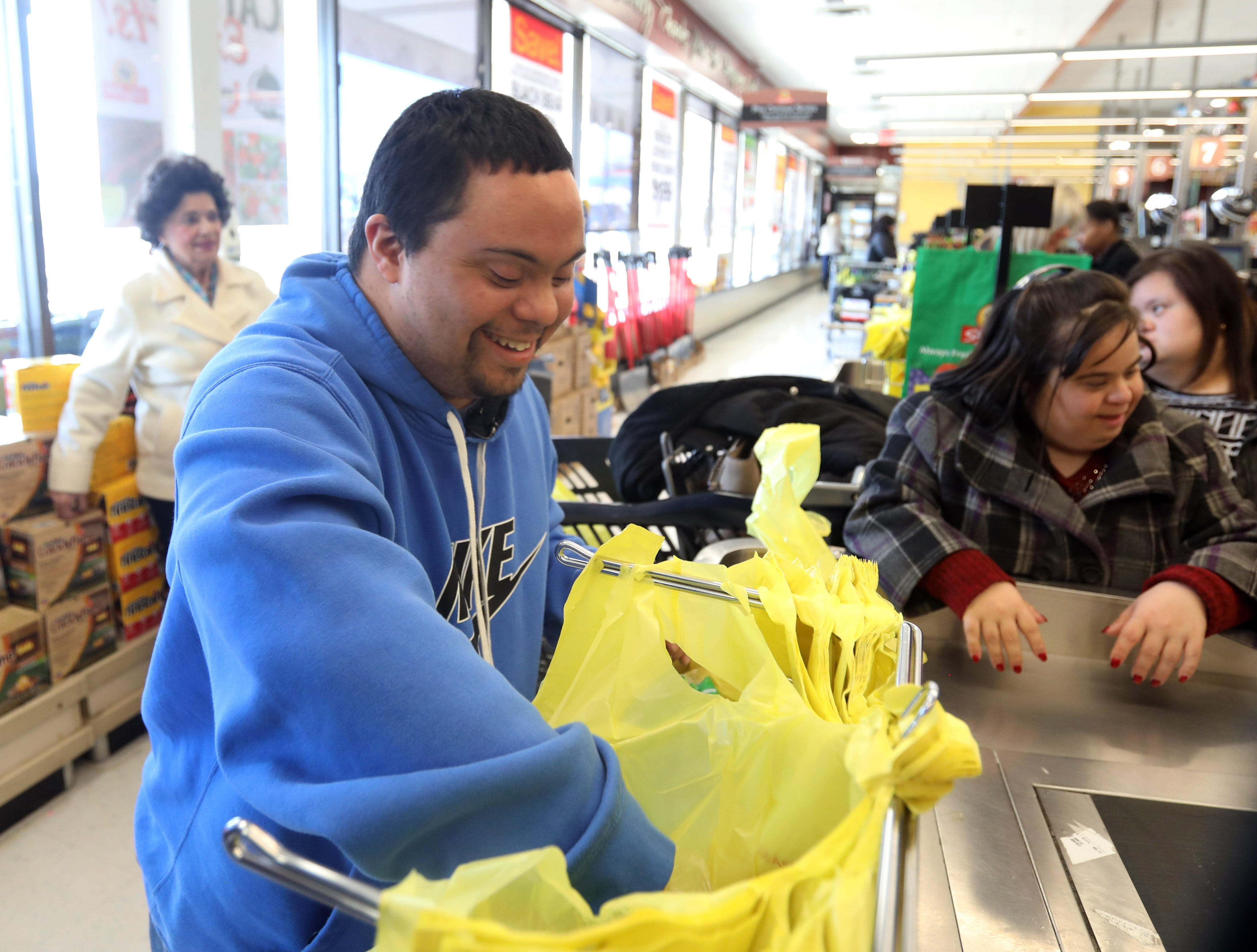 Anthony Mundy, 29 bags the groceries after shopping for lunch with members of his day program at Jawonio at ShopRite in Airmont March 12, 2019. The group met with a dietitian to help shop for a healthy lunch to make.