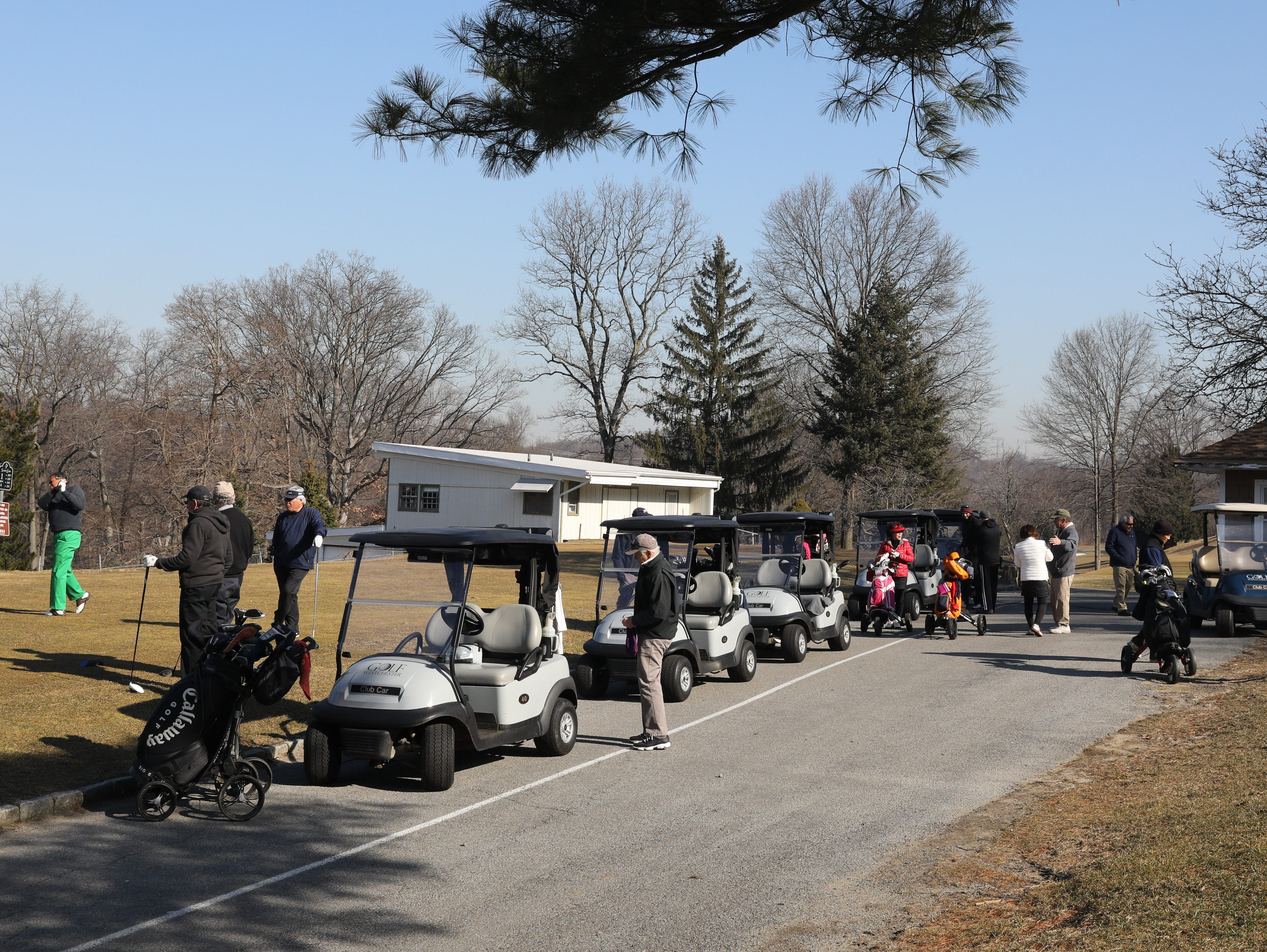 "Golfers tee off on the first tee, after a three hour ""frost delay"" during the opening day of golfing at Sprain Lake Golf Course in Yonkers, March 20, 2019."