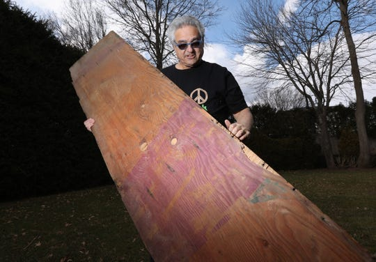 Steve Gold with a piece of the stage floor from the original Woodstock festival at his New City home March 19, 2019. His company, Peace of Woodstock Stage, is selling items made from the wood.
