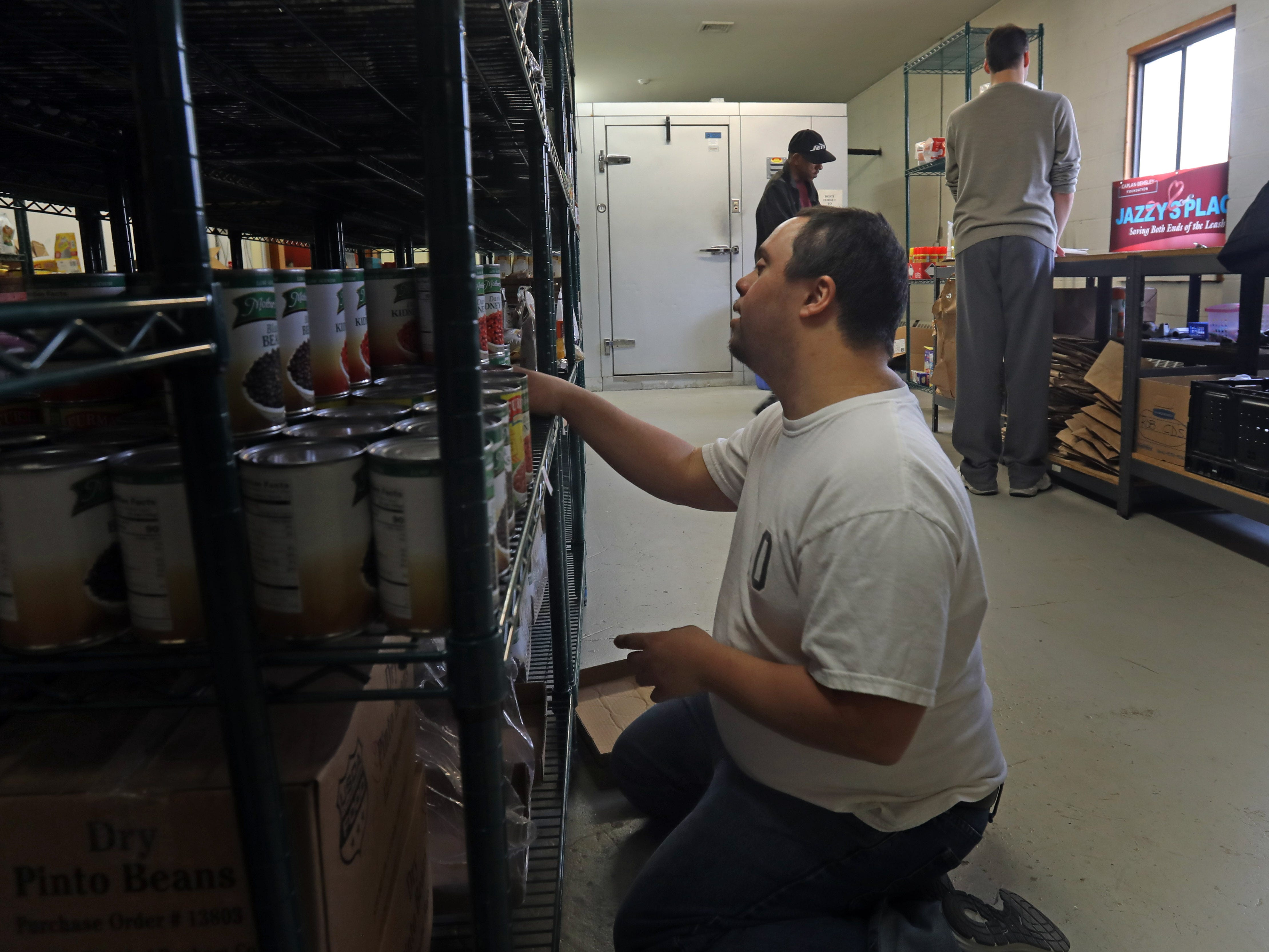 Anthony Mundy, 29 volunteers at TOUCH where he stocks the shelves in Valley Cottage March 13, 2019.