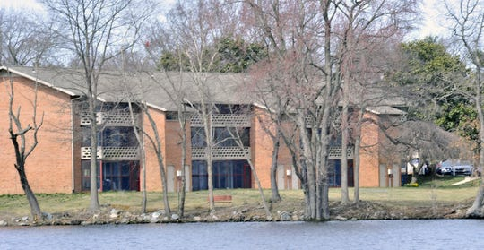 Lake Club apartments on the east side of Silver Lake in Dover where the body of a Wesley college student was found recently .