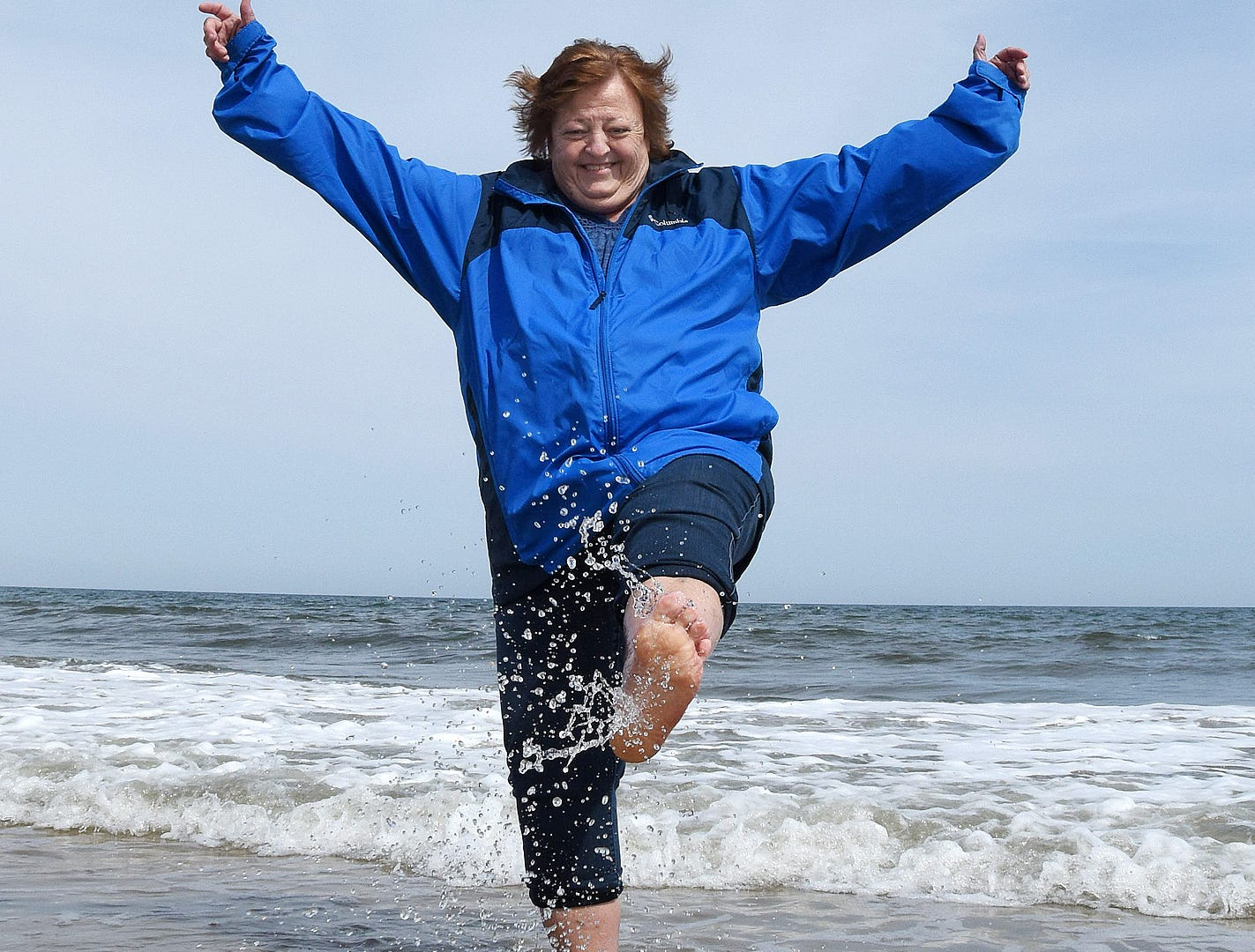 Roxanne Bross from Woodbridge, Va. splashes in the 48-degree-water as the first day of spring had cooler temperatures at Rehoboth Beach Wednesday.